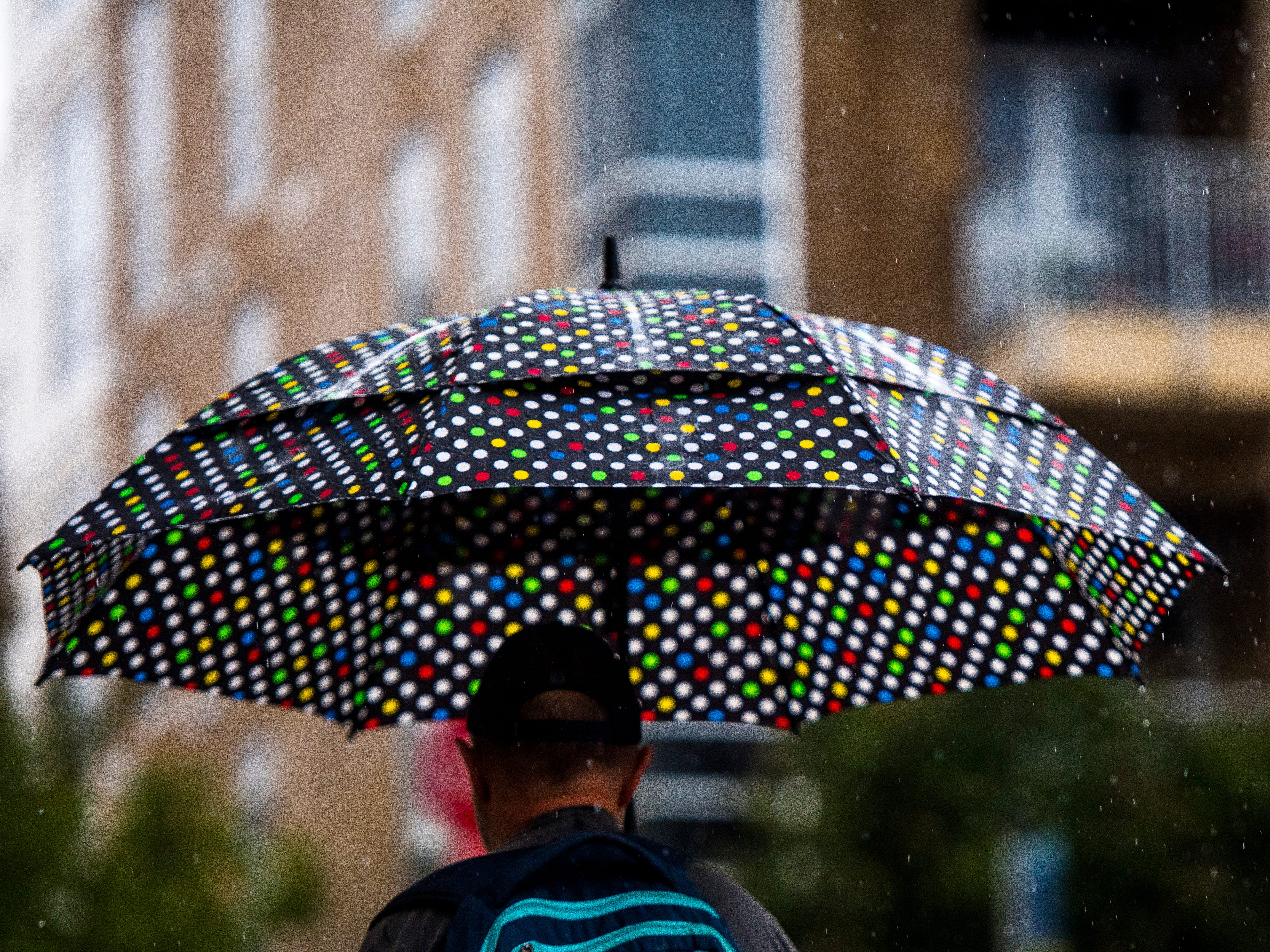 Rain falls on a colorful dotted umbrella in downtown Knoxville on Wednesday, September 26, 2018.