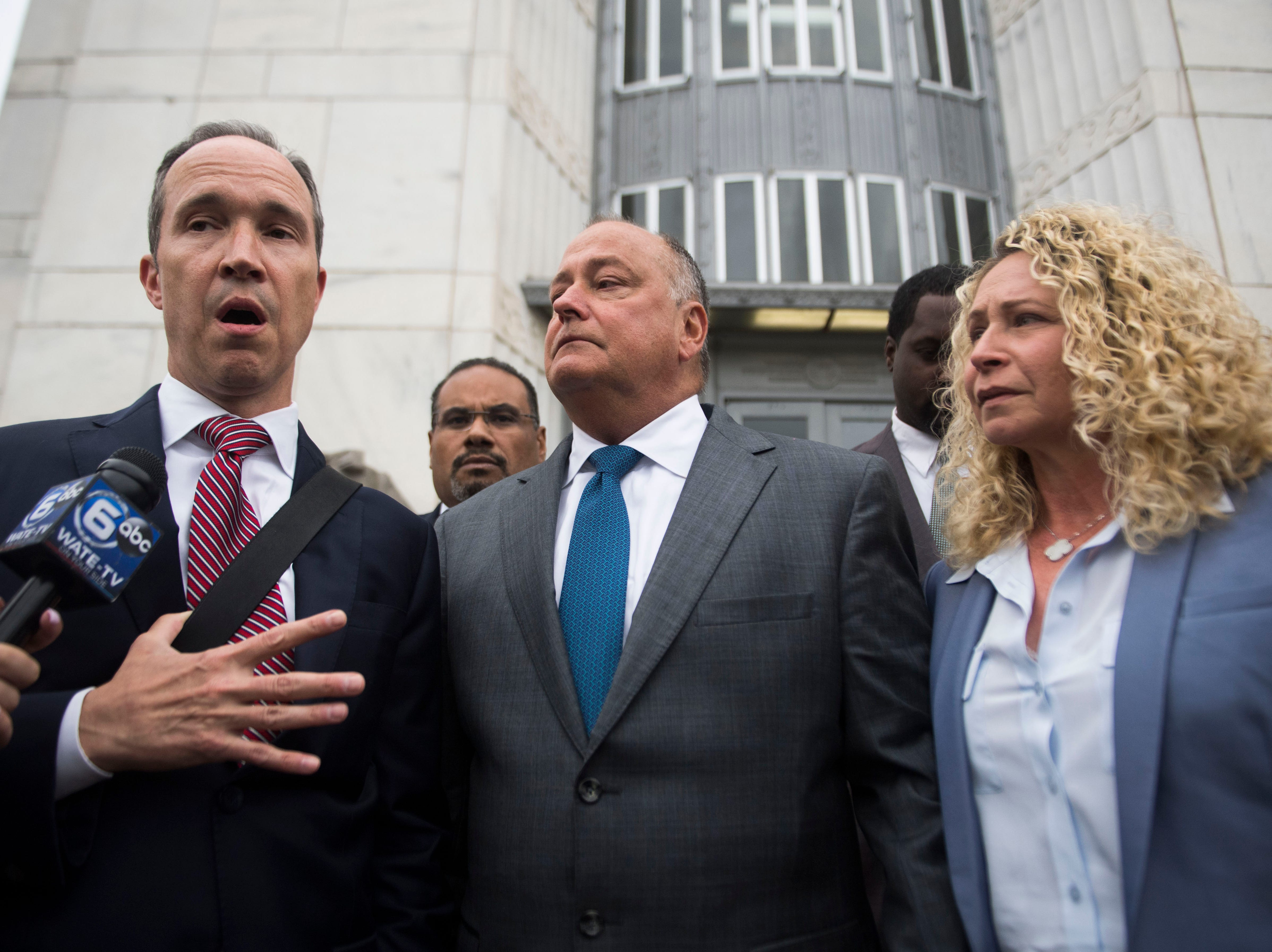 Former Pilot Flying J President Mark Hazelwood, center, exits the federal courthouse with his wife, Joanne, in Chattanooga on Sept. 26, 2018.  Hazelwood was sentenced to 150 months in prison and fined $750,000 by Senior U.S. District Judge Curtis L. Collier.