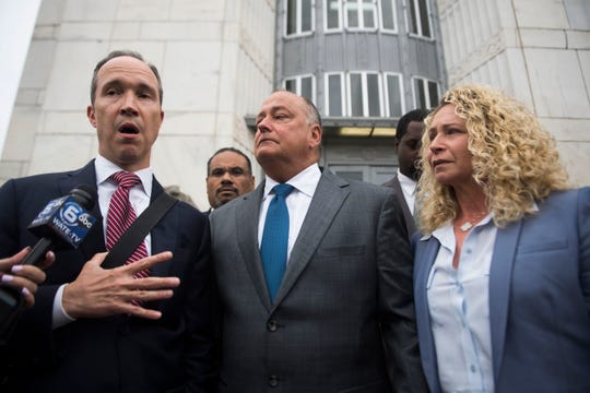 Former Pilot Flying J President Mark Hazelwood, center, exits the federal courthouse with his wife, Joanne, in Chattanooga on Wednesday, Sept. 26, 2018. Hazelwood was sentenced to 150 months in prison and fined $750,000 by Senior U.S. District Judge Curtis Collier.