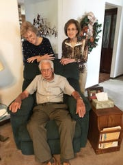 Edna Harrison Bennett of Clearwater, Fla., and Joan Harrison Hensley of Fountain City take a moment to dote on their dad, Rubel Harrison, who will celebrate his hundredth birthday later this month.