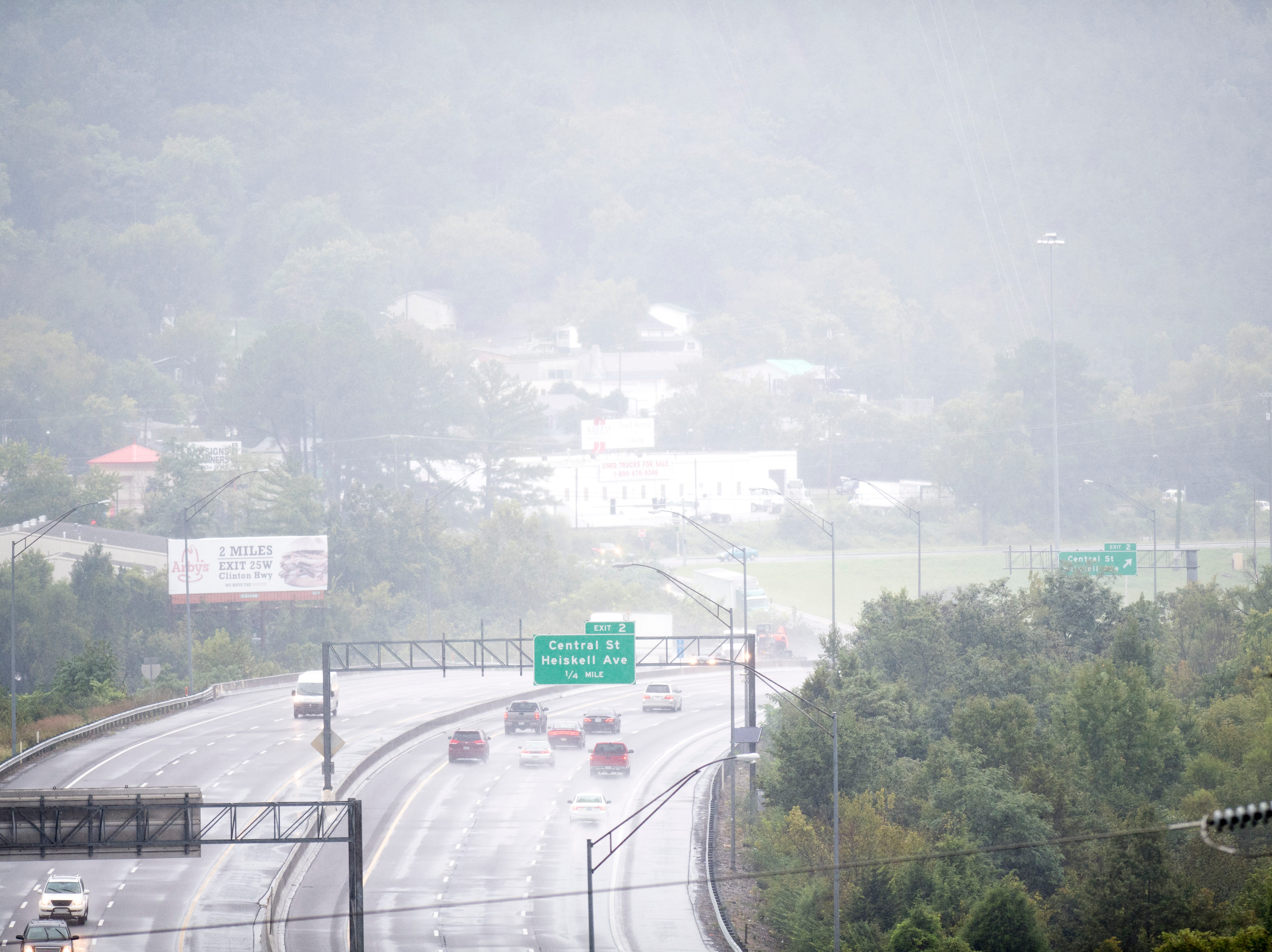 Heavy rains obscure the view of I-275 during an afternoon rain shower in Knoxville, Tennessee on Wednesday, September 26, 2018. A flood watch for the area was issued around 1pm until 7pm.
