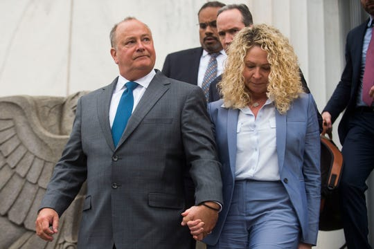 Former Pilot Flying J President Mark Hazelwood exits the federal courthouse with his wife, Joanne, in Chattanooga on Wednesday, Sept. 26, 2018. Hazelwood was sentenced to 150 months in prison and fined $750,000 by U.S. District Judge Curtis Collier.
