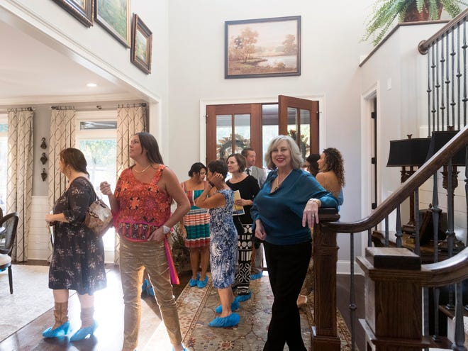Guests enter into the foyer to tour the home of Scott and Hope Davis on Tuesday, September 25, 2018. The Davis' home is the featured home for Alzheimer's Tennessee's inaugural Designer Home & Garden Tour.
