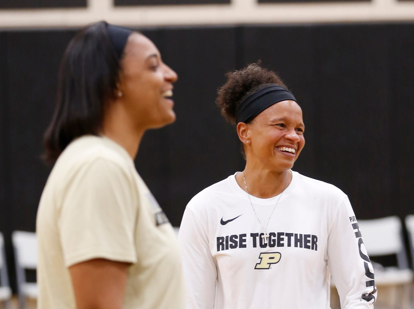 Assistant coach Lyndsay Wisdom-Hylton, left, and Jen Jones, director of strength and conditioning, share a laugh as Purdue women's basketball begins practice Wednesday, September 26, 2018, at Cardinal Court in Mackey Arena.
