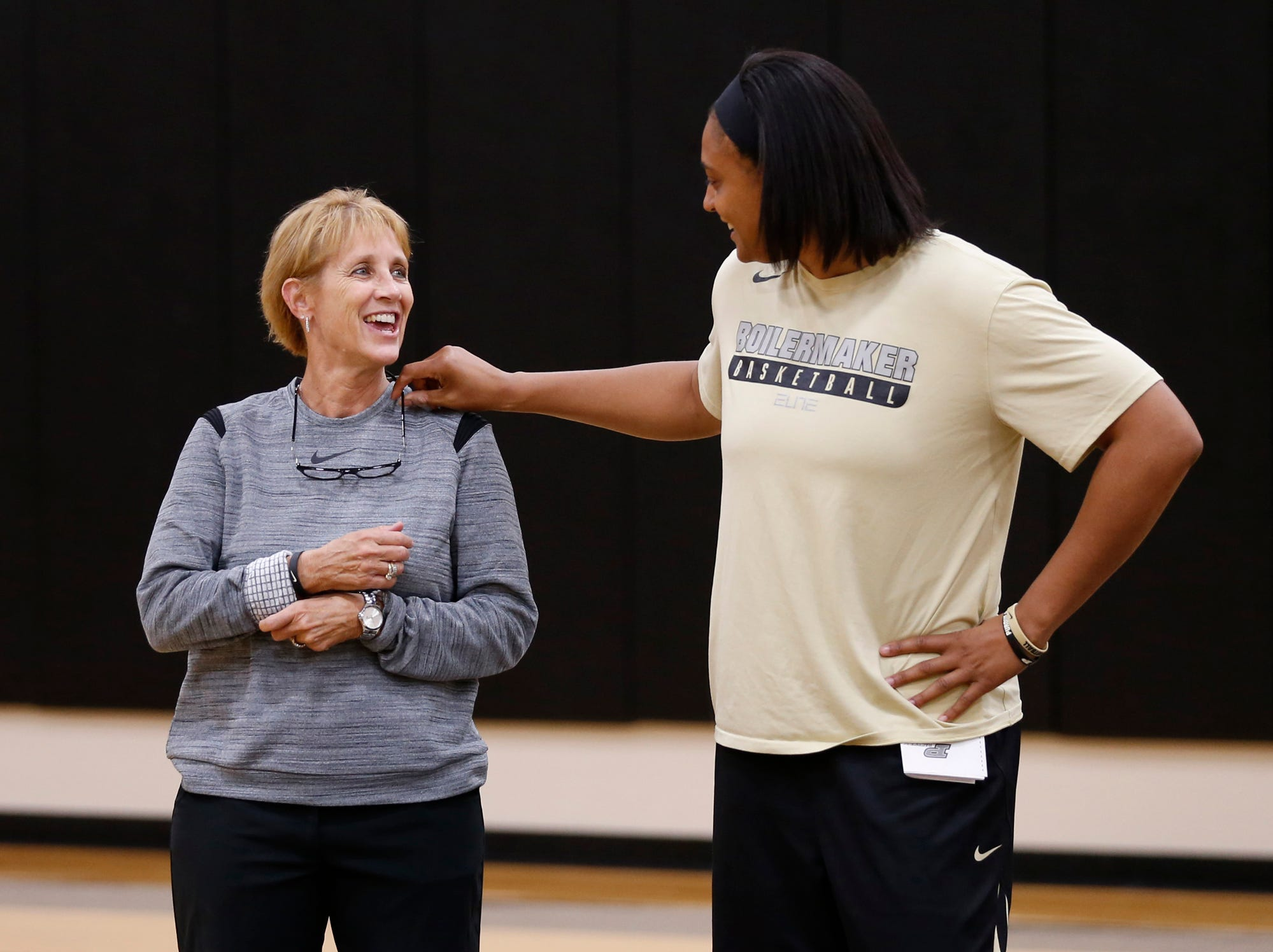 Terry Kix, left, director of basketball operations, and assistant coach Lyndsay Wisdom-Hylton laugh as they talk during Purdue women's basketball practice Wednesday, September 26, 2018, at Cardinal Court in Mackey Arena.