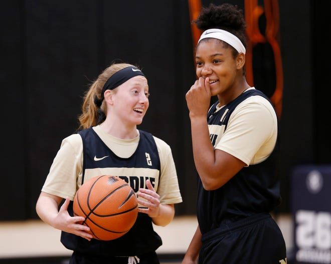 Abby Abel, left, and Dominique Oden share a laugh during Purdue women's basketball practice Wednesday, September 26, 2018, at Cardinal Court in Mackey Arena.