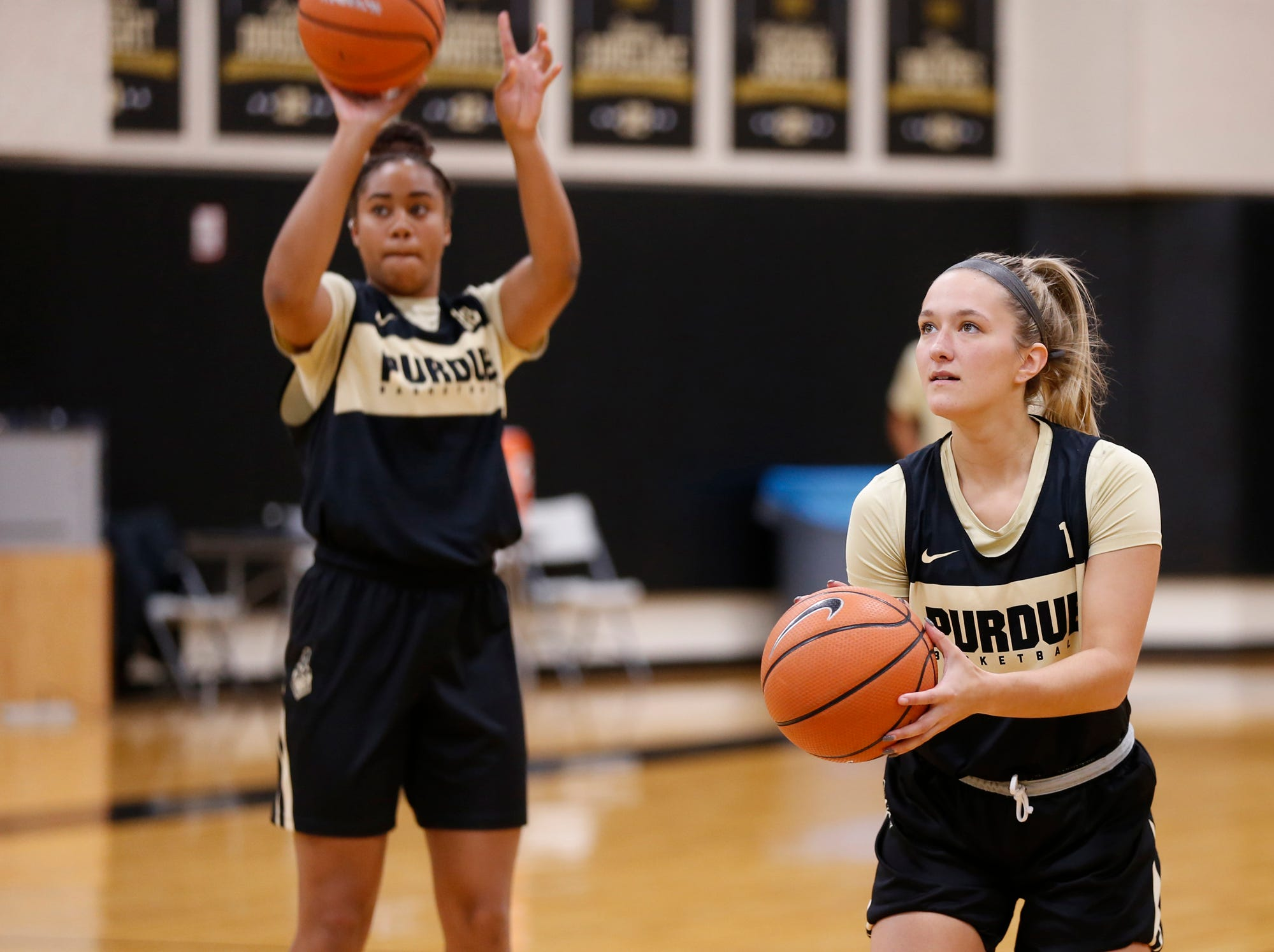 Karissa McLaughlin, right, lines up a shot before the start of the practice for Purdue women's basketball Wednesday, September 26, 2018, at Cardinal Court in Mackey Arena.
