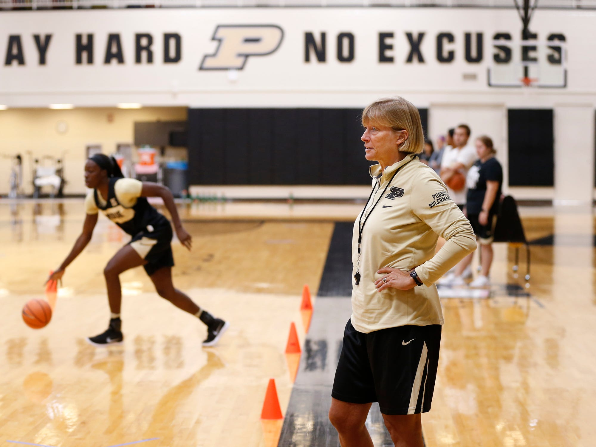 Head coach Sharon Versyp looks on as players run a series of dribbling drills during Purdue women's basketball Wednesday, September 26, 2018, at Cardinal Court in Mackey Arena.