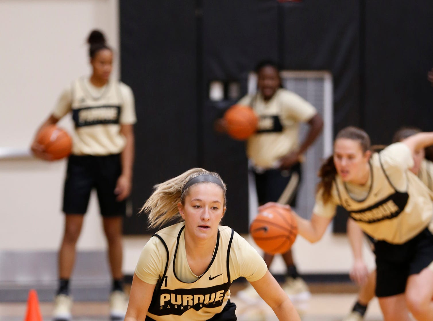 Karissa McLaughlin runs through a dribbling drill during practice for Purdue women's basketball Wednesday, September 26, 2018, at Cardinal Court in Mackey Arena.