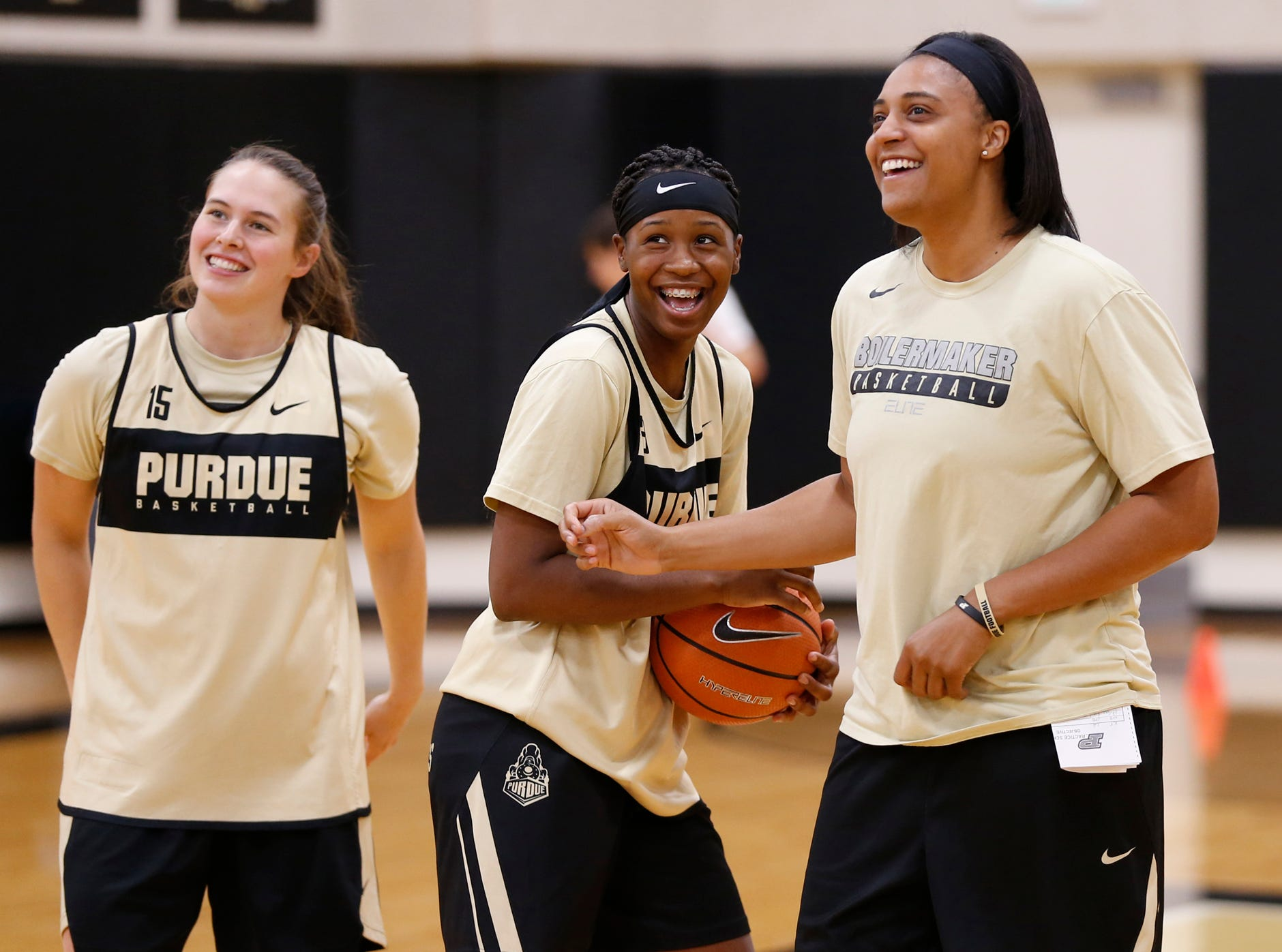 Assistant coach Lindsay Wisdom-Hylton, right, shares a laugh with Lyndsey Whilby, center, and Léony Boudreau at Purdue women's basketball practice Wednesday, September 26, 2018, at Cardinal Court in Mackey Arena.