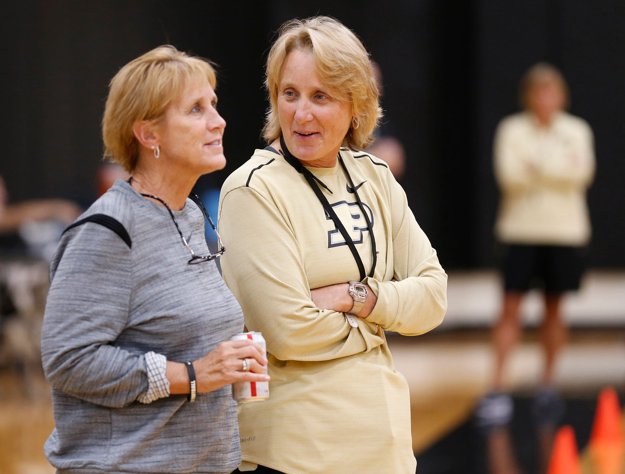 Terry Kix, left, director of basketball operations, and assistant coach Beth Couture talk during Purdue women's basketball practice Wednesday, September 26, 2018, at Cardinal Court in Mackey Arena.