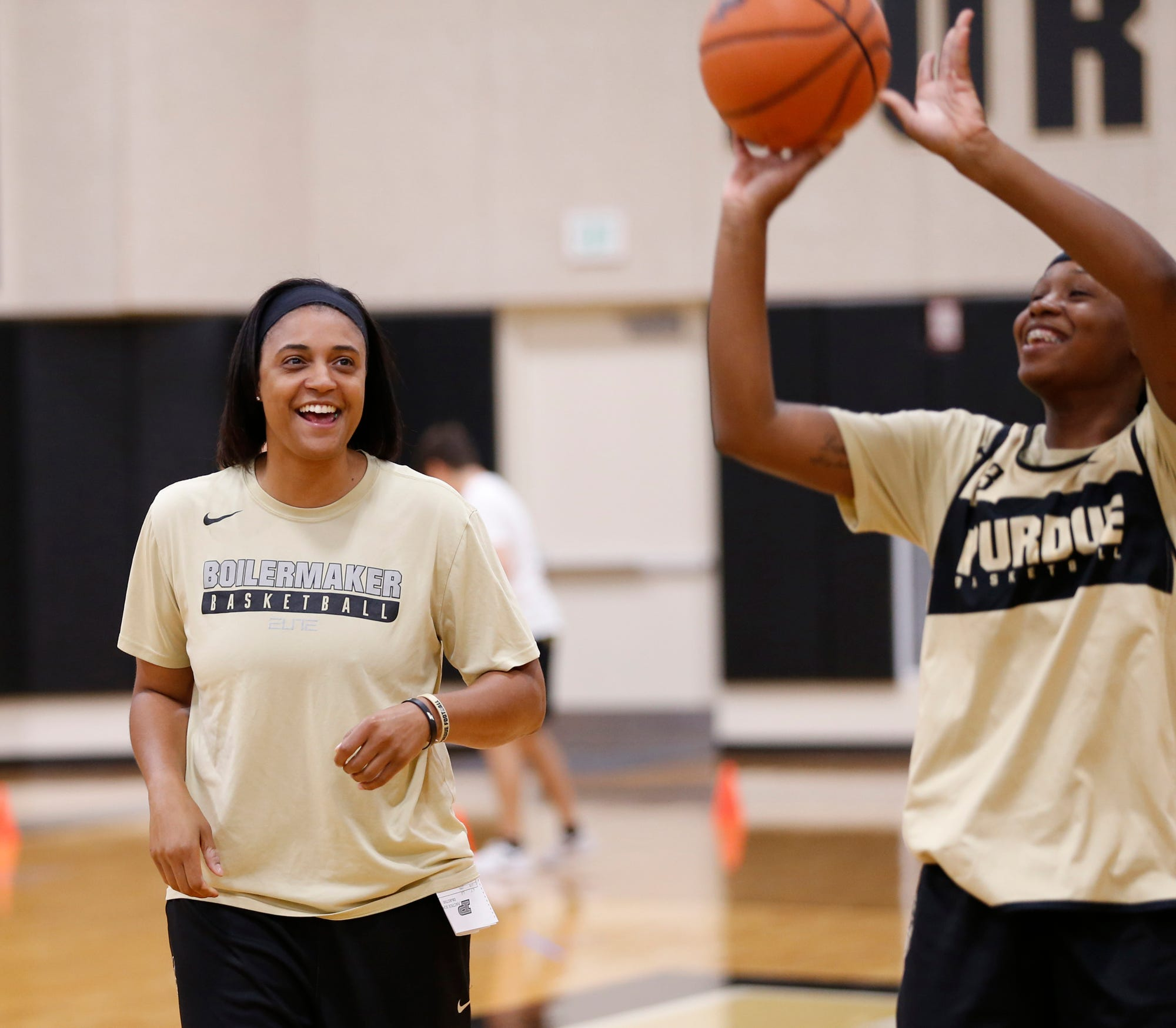 Assistant coach Lindsay Wisdom-Hylton, left, has a laugh with Lyndsey Whilby at Purdue women's basketball practice Wednesday, September 26, 2018, at Cardinal Court in Mackey Arena.