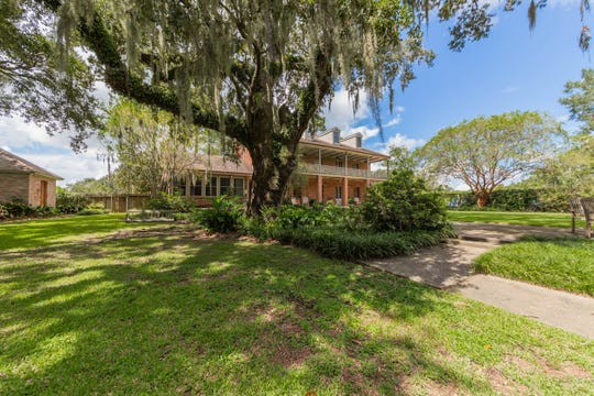 This estate sits on several acres along the Bayou Teche.