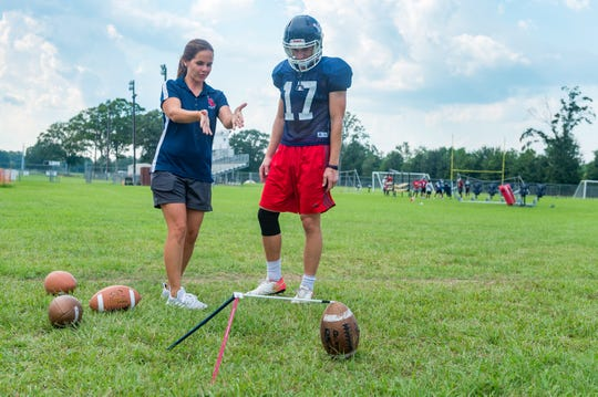 Lafayette Christian specialists coach Spring Woodson instructs her son, Knights senior kicker Colin LaHaye, at a practice on Sept. 18, 2018.