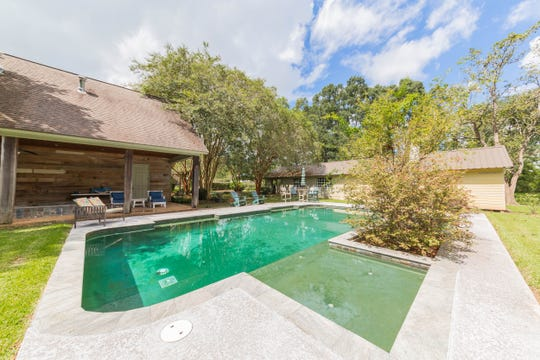The pool area has plenty of space for outdoor entertaining.
