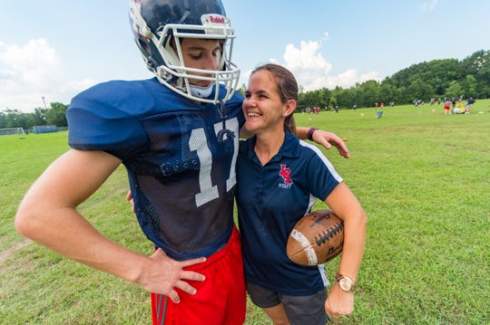 Lafayette Christian senior kicker Colin LaHaye embraces his mother, Knights specialists coach Spring Woodson, at practice on Sept. 18, 2018.