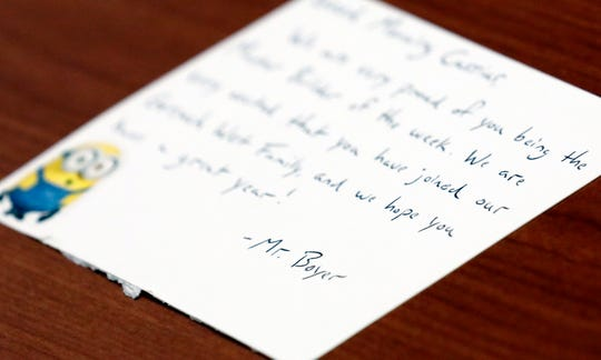 Kevin Boyer, a family and student support coordinator at Gorsuch West Elementary, writes a note to each student at Lancaster school. About 600 students attend the school.