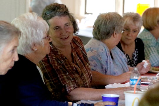 Ruth Johnson smiles as she talks to Lori Boyd Tuesday, Sept. 11, 2018, at Rising Park in Lancaster. The two women are part of a group of retired Fairfield Medical Center employees who knew Susan Clark that meets monthly. Johnson a few other friends of Clark had lunch with Clark in 2016 at the hospice she was living in. The retired FMC nurse asked her friends to start a monthly gathering so they could stay in touch with each another.