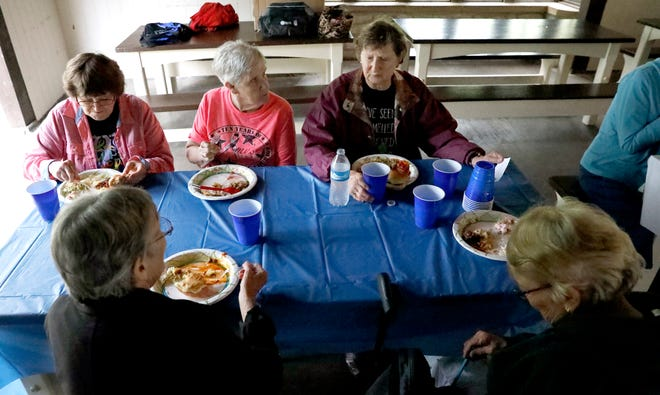 (left to right) Nancy Anders, Dori Nelms, Marilyn Waits, Carol West and Alice Rader have lunch together Tuesday, Sept. 11, 2018, at Rising Park in Lancaster. The five women are part of a group of retired Fairfield Medical Center nurses who began gathering at the request of their late friend Susan Clark two years ago.
