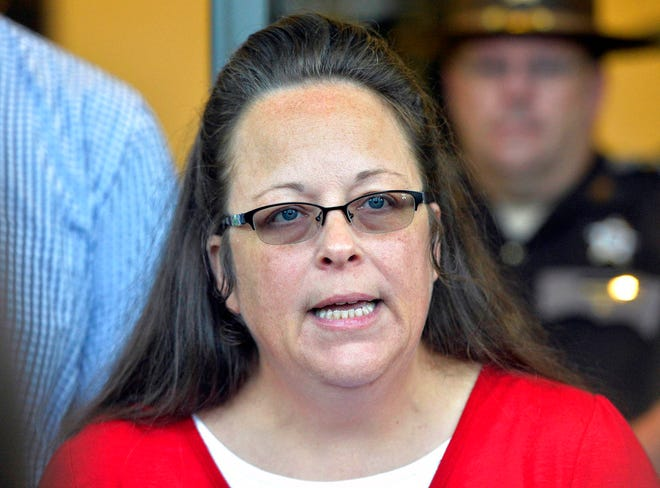 In this Sept. 14, 2015, file photo, Rowan County Clerk Kim Davis makes a statement to the media at the front door of the Rowan County Judicial Center in Morehead, Ky.