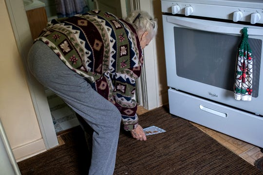 Lois Faggion, 87, checks a rodent trap on Tuesday, Sept. 25, 2018, at her home in Lansing. Faggion's says she needs help to rid her home of a rat invasion. The house has not been maintained as well as it once was since her husband Bob died 20 years ago.