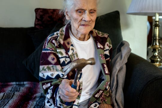 Lois Faggion, 87, holds the hammer that she used to put rats stuck in a trap out of their misery while talking about her rodent invasion on Tuesday, Sept. 25, 2018, in Lansing. She says she needs help getting the rats removed from her home. The house has not been maintained as well as it once was since her husband Bob died 20 years ago.
