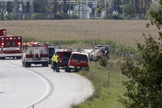 Fire and rescue crews respond to an overturned tanker on Interstate 43 and mile marker 151 Wednesday, Sept. 26, in Manitowoc.