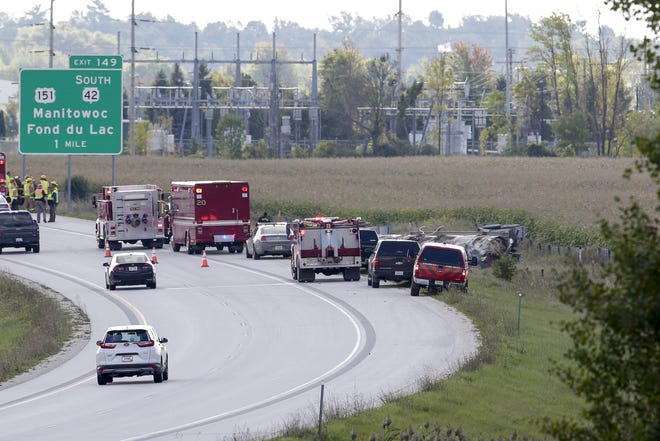 Fire and rescue crews respond to an overturned tanker on Interstate 43 and mile marker 151 in Manitowoc Wednesday, Sept. 26.