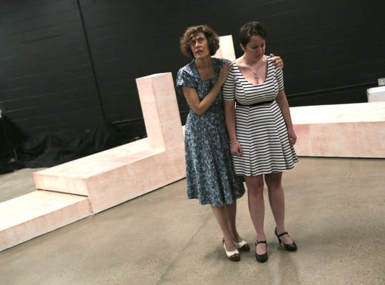 Lori Turner (left) and Maddie Beer-Penwell act out a scene during a rehearsal of the Light in the Piazza.