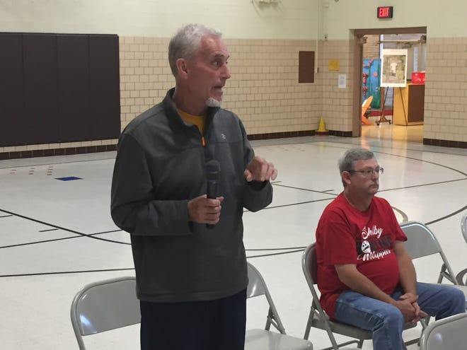 Denny Adam asks a question at Tuesday's town hall meeting at Dowds Elementary School.