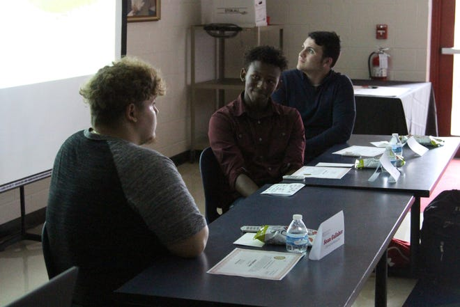 Sean Galleher, 18, looks towards classmates Dorien Terrance, 16, and Robert Vick, 17, as they highlighted the effects of food insecurity in Marion County during a community conversation on Tuesday.