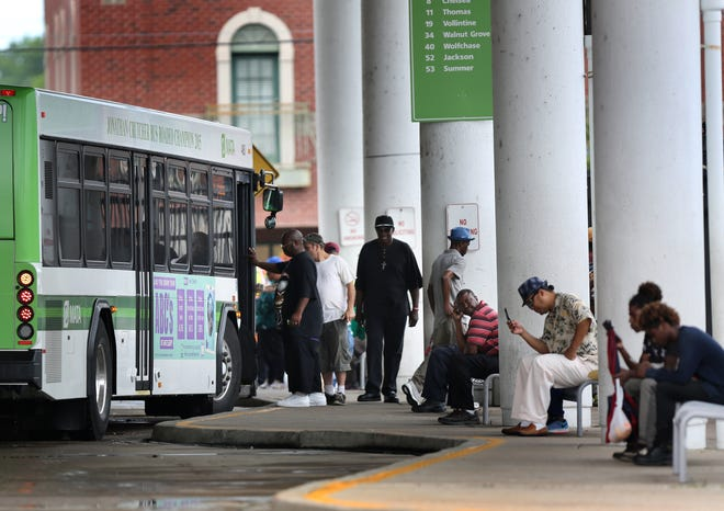 Riders board a MATA bus at the main terminal in downtown Memphis on July 14, 2016.