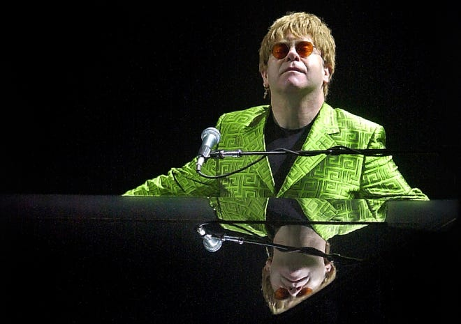 Pop music icon Elton John finishes the final chords of his first duet with fellow superstar Billy Joel at the Pyramid during a 2001 performance in Memphis.