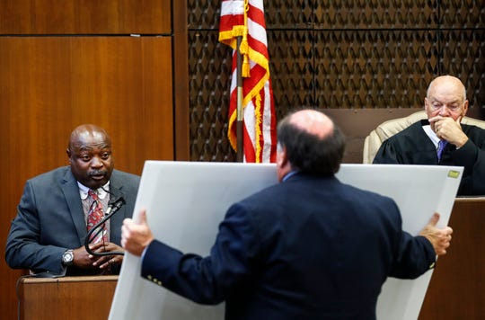 Judge Gerald Chatham (right) listens as lead prosecutor John Champion (middle) examines witness Lt. Edward Dickson (left) on the second day of the retrial of Quinton Tellis in Batesville, Mississippi on Wednesday. Tellis is charged with burning 19-year-old Jessica Chambers to death almost three years ago on Dec. 6, 2014. Tellis has pleaded not guilty to the murder.