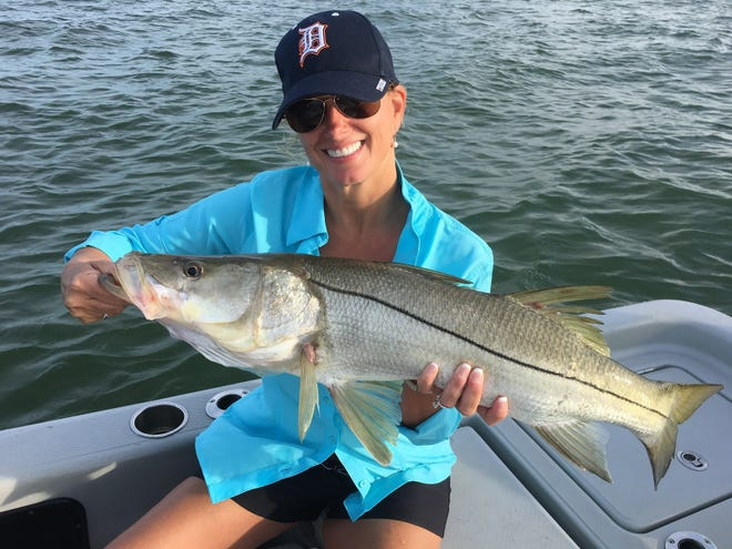 Sherrie Cousineau with her first snook while on vacation; fishing with Capt Christian Sommer.