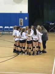 Marco Island coach Alyssa Stolinas chats with her team during a timeout during a recent match.