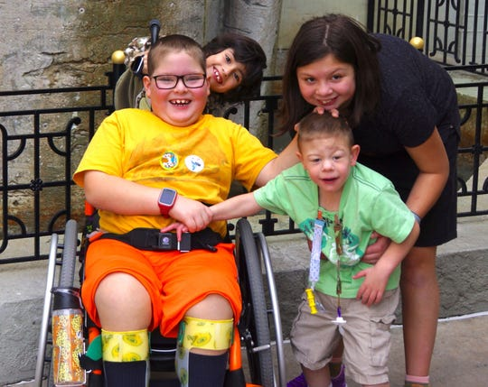 The Langlois children enjoy Disney World earlier this year. From left, they are Gabriel, Hannah, Tyler and Alicia.