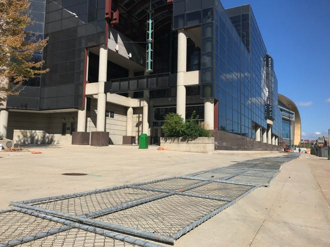 Workers began installing chain link fence around the Bradley Center Wednesday in anticipation of the demolition of the 30-year-old arena.