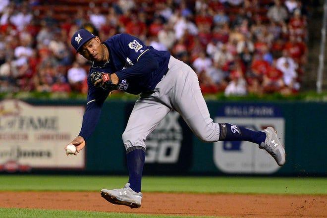Brewers second baseman Jonathan Schoop makes a nice play on Kolten Wong's bunt attempt.