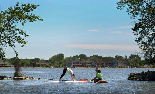 If paddleboarding or yoga isn't enough of a challenge on its own, try combining them with a class on Pewaukee Lake.