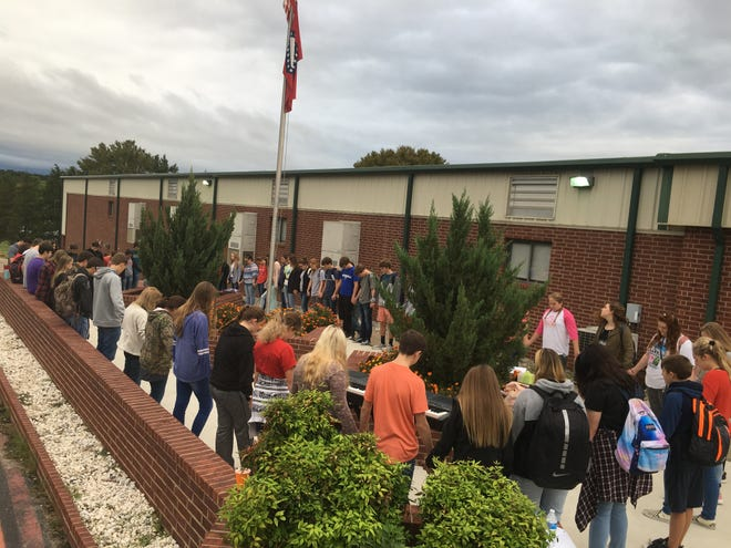 "Calico Rock High School students, teachers and members of the community gathered around flag pole for fellowship and prayer on the ""See you at the Pole"" National Day of Prayer."