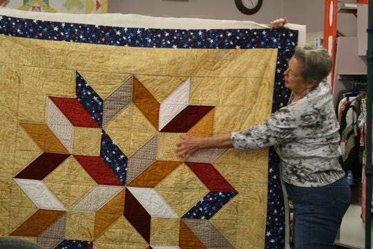 "Mountain Home Quilts of Valor Group Leader Mary Hazel of Mountain Home displays a ""carpenter star"" designed quilt. The group started in Mountain Home in 2015 with only four quilters, now the group has 19. The women meet the fourth Wednesday of the month at 10 a.m. at the Remember Me Quilt Shop on Main Street."