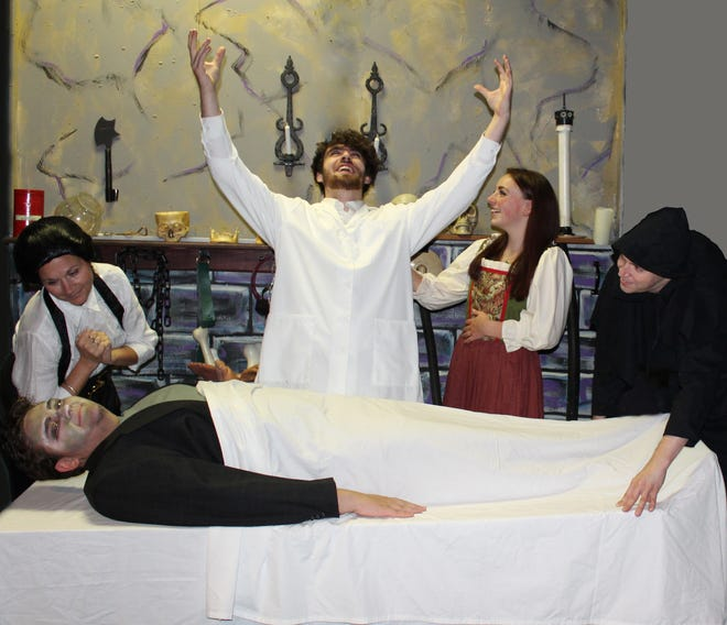 "The Monster (on slab, played by Alex Gelpke) is the focus of the attention of (left to right) Frau Blucher (Rose Marie Franklin), Frederick von Frankenstein (Joe Bellina), Inga (Alex Scano), and Igor (Daniel Ryan) in ""Young Frankenstein.""  The musical version of the 1974 comedy by Mel Brooks opens at Brundage Park Playhouse on Friday, October 5."