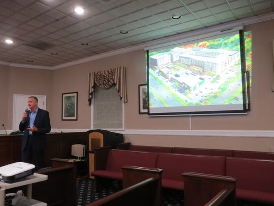 Parsippany township planner Edward Snieckus narrates a multimedia presentation about a mixed-use redevelopment plan on Route 10.