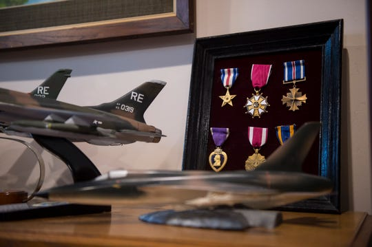 Ted Lowry, candidate for District 2 Board of Education medals from his time in the Air Force at his home in Montgomery, Ala., on Wednesday, Sept. 26, 2018.