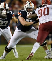 Auburn offensive lineman Jack Driscoll blocks an Arkansas defender on Saturday, Sept. 22, 2018 in Auburn, Ala.