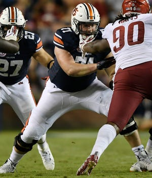 Auburn offensive lineman Jack Driscoll blocks an Arkansas defender on Saturday, Sept. 22, 2018 in Auburn, Ala.