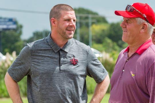 Louisiana coach Billy Napier talking to a golfer at a Ragin' Cajuns fund-raising golf outing last week in Lafayette, La.
