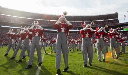 Members of the Million Dollar Band perform during halftime.