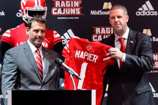 Dec 18, 2017; Lafayette, LA, USA; Billy Napier (right) is introduced as the Louisiana-Lafayette Ragin Cajun head football coach by Director of athletics Bryan Maggard. Mandatory Credit: Scott Clause/Montgomery Advertiser via USA TODAY NETWORK